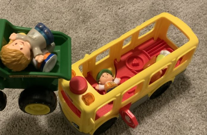 Toy dump truck and school bus