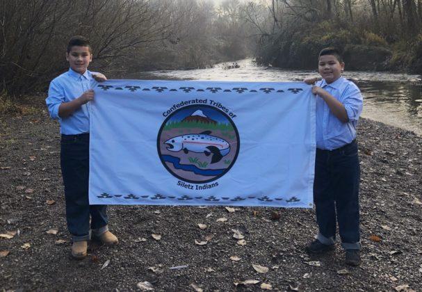 Jacoby and Julian Jones with Siletz flag