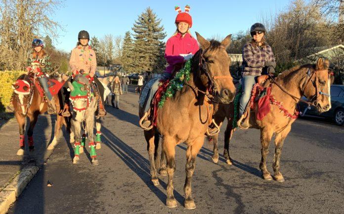 Christmas carolers on horseback
