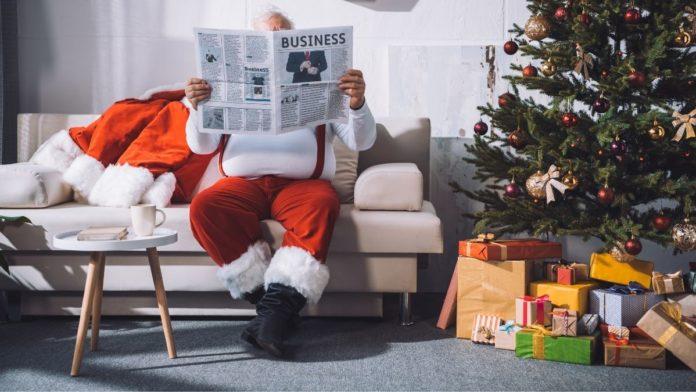 Santa Claus reading a newspaper