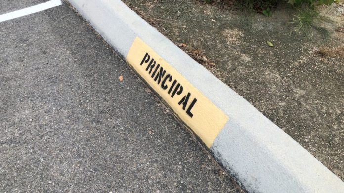 Reserved parking space for principal
