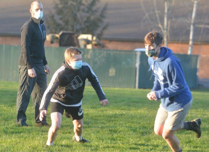 Alek Russell, Blake Niemann, Shane Stueve in football practice
