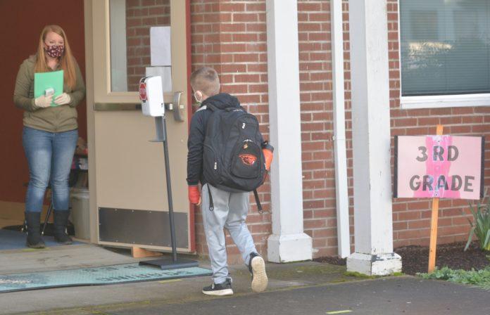 Third grader entering building