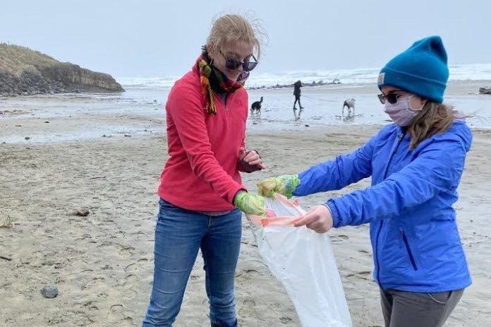 Picking up trash on beach