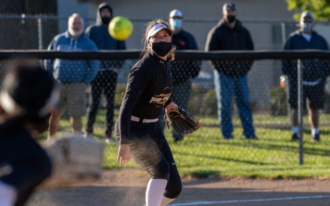 Melanie Baldwin throws to first base