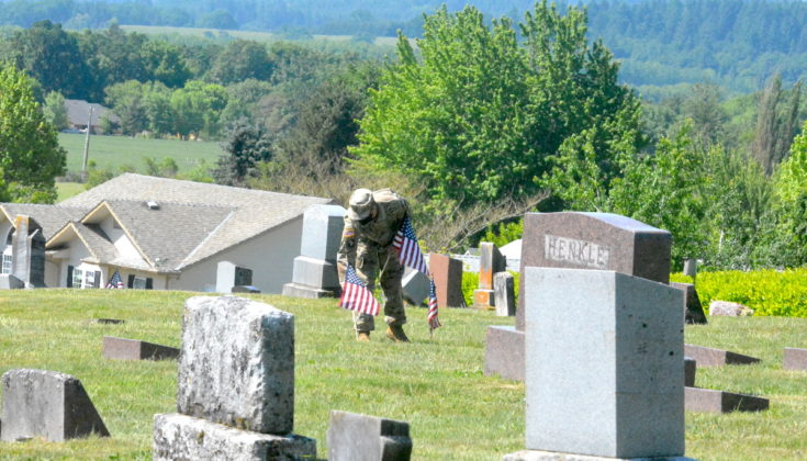 Placing flags on grave site