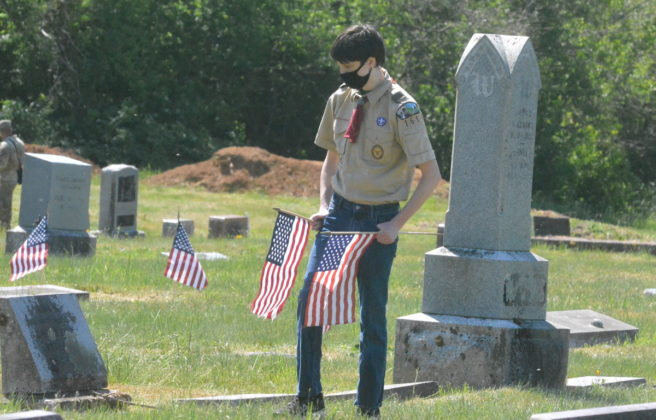 Boy Scout looking to place flags