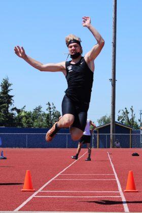Caleb Jensen in long jump