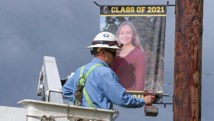 Ken Pearce installing senior portrait