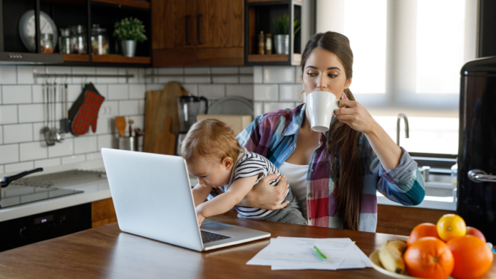 Mom working with infant on her lap