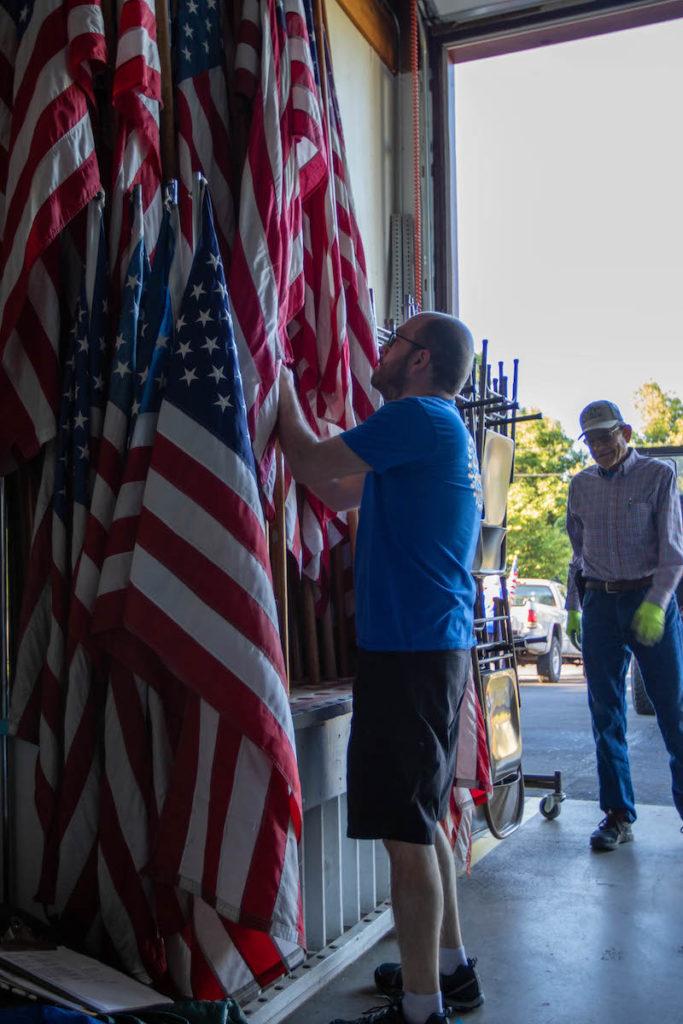 Brent Kaseman and Oscar Gutbrod retrieve flags from Philomath Fire & Rescue