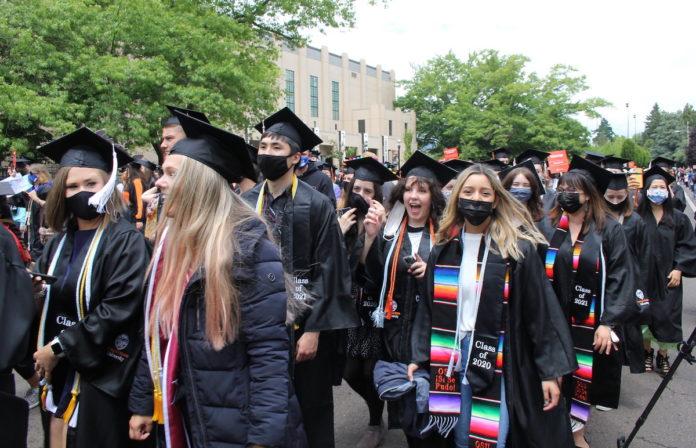 OSU graduates in an information procession through campus
