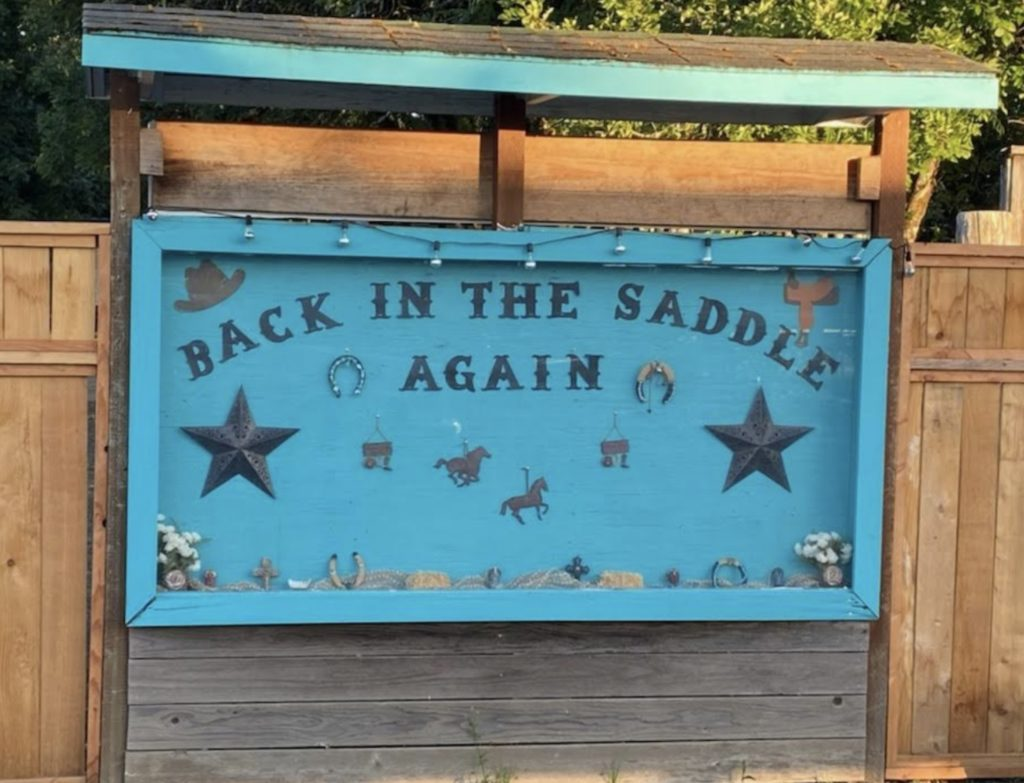 Back in the Saddle Again sign