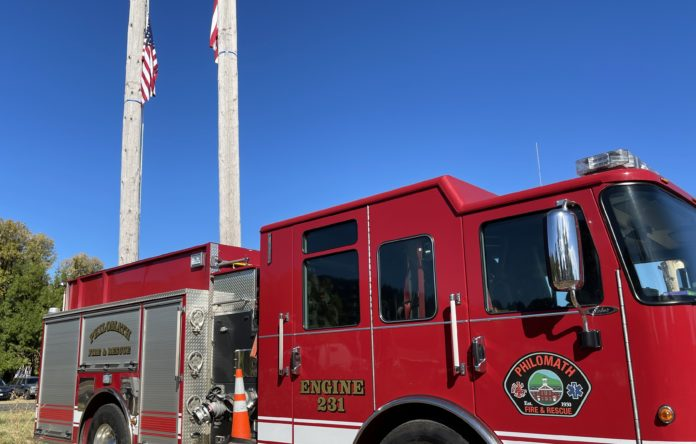 Philomath Fire & Rescue engine under flags