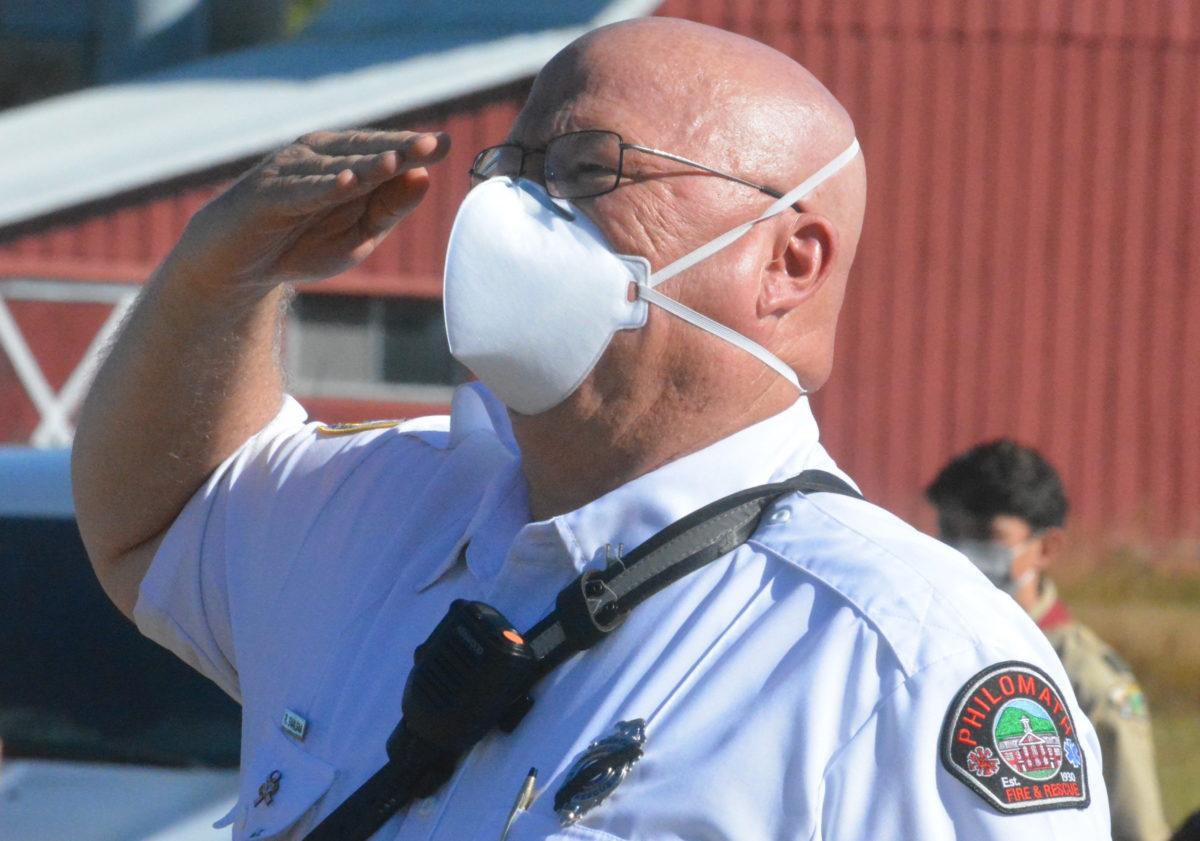 Capt. Rich Saalsaa saluting